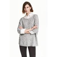 H&M Sweter robiony lewym ściegiem 0244267004 Czarny/Biały melanż