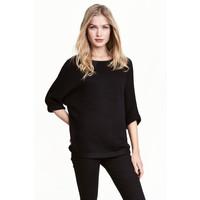 H&M Sweter robiony lewym ściegiem 0244267014 Czarny
