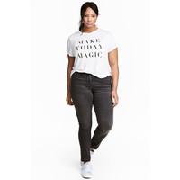H&M H&M+ Elastyczne spodnie 0352811023 Prawie czarny